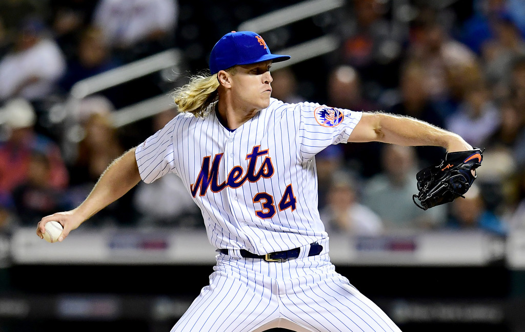 New York Mets pitcher Noah Syndergaard pitches during the first inning against the Miami Marlins