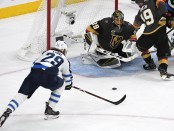 Winnipeg Jets right winger Patrik Laine attempts a shot against Marc-André Fleury against the Vegas Golden Knights