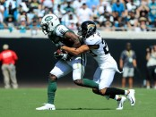 New York Jets wide receiver Quincy Enunwa is tackled by Tyler Patmon against the Jacksonville Jaguars