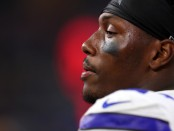 Former Dallas Cowboys defensive end Taco Charlton watches from the sidelines against the Indianapolis Colts