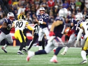 New England Patriots quarterback Tom Brady looks to pass during the first half against the Pittsburgh Steelers