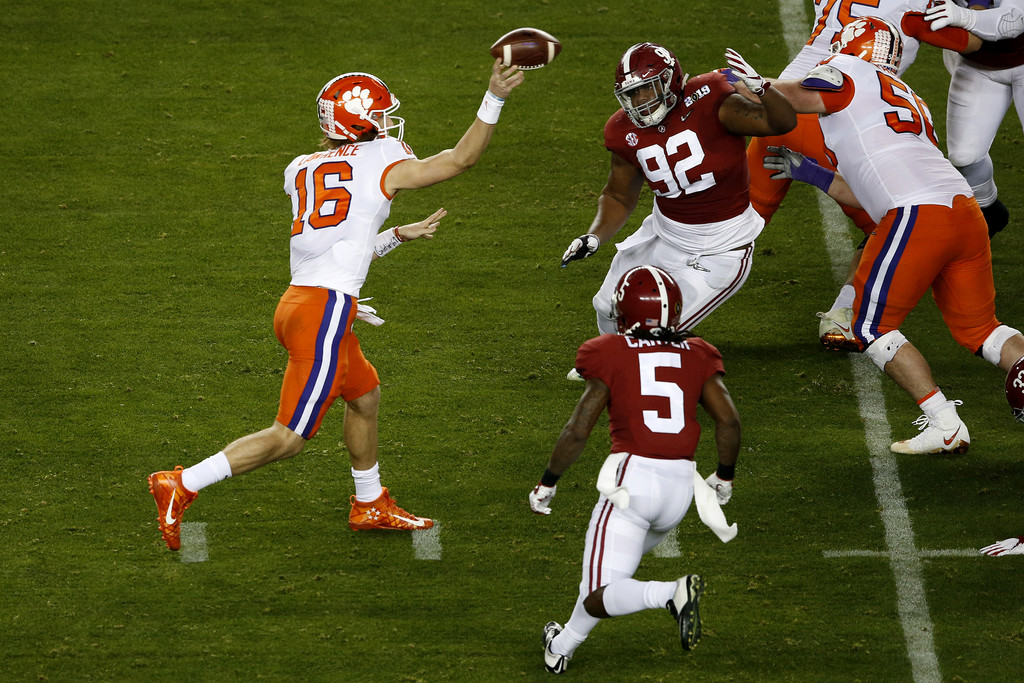 Clemson Tigers quarterback Trevor Lawrence throws a pass against the Alabama Crimson Tide in the 2019 College Football Playoff National Championship game
