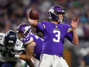 Minnesota Vikings quarterback Trevor Siemian attempts to pass the football against the Seattle Seahawks in the 2018 NFL preseason