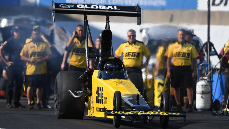 JEGS.com/McPhillips Racing Top Alcohol Dragster pilot Troy Coughlin Jr. racing on Sunday at the Mopar Express Lane NHRA Nationals presented by Pennzoil