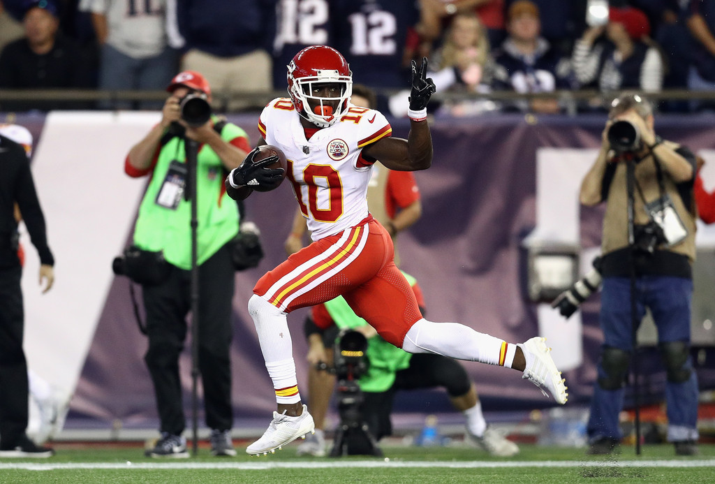 Kansas City Chiefs wide receiver Tyreek Hill celebrates on his way to a touchdown against the New England Patriots