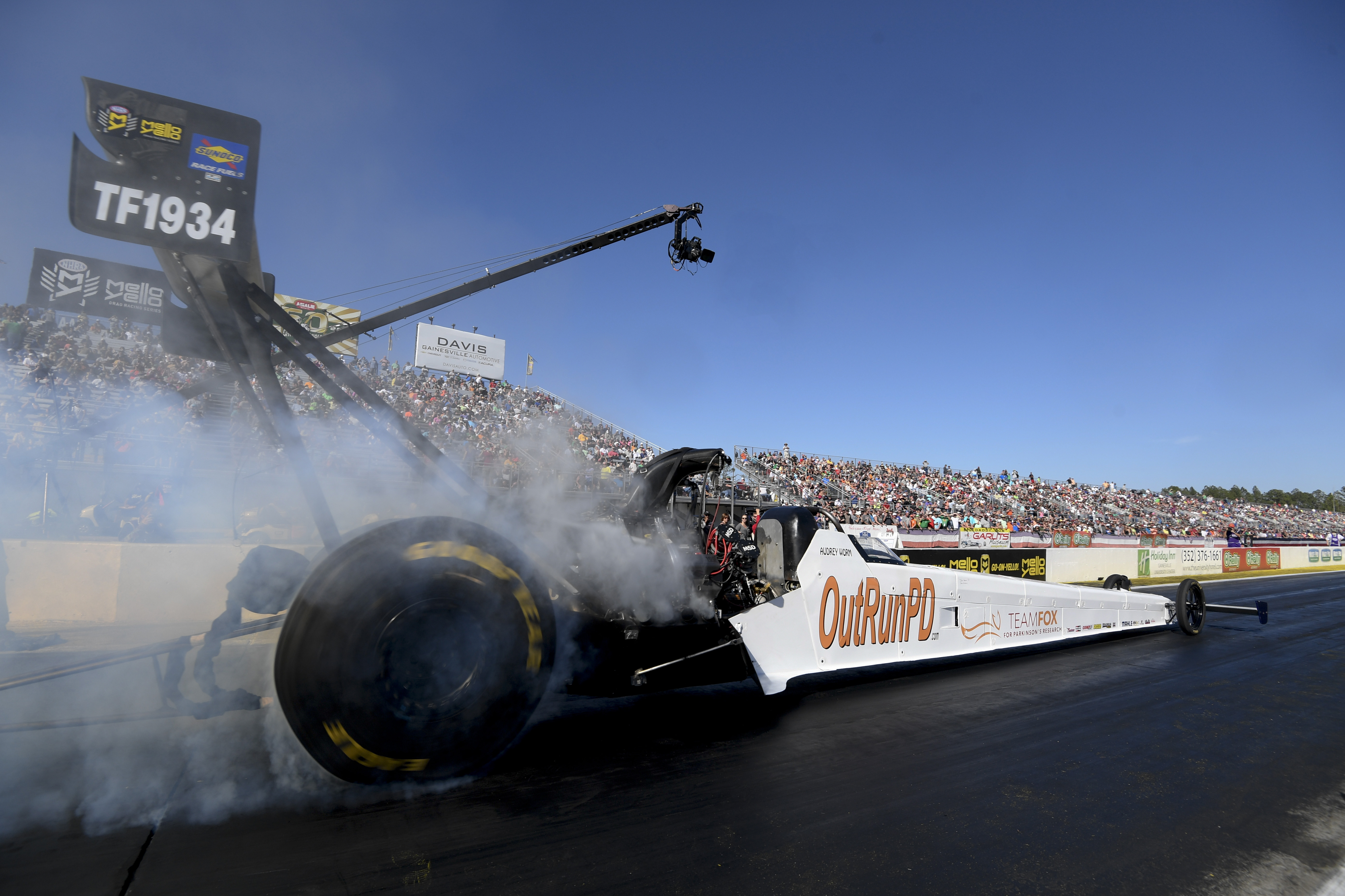 Former Leverich Racing Top Fuel Dragster pilot Audrey Worm piloting the dragster in a national event