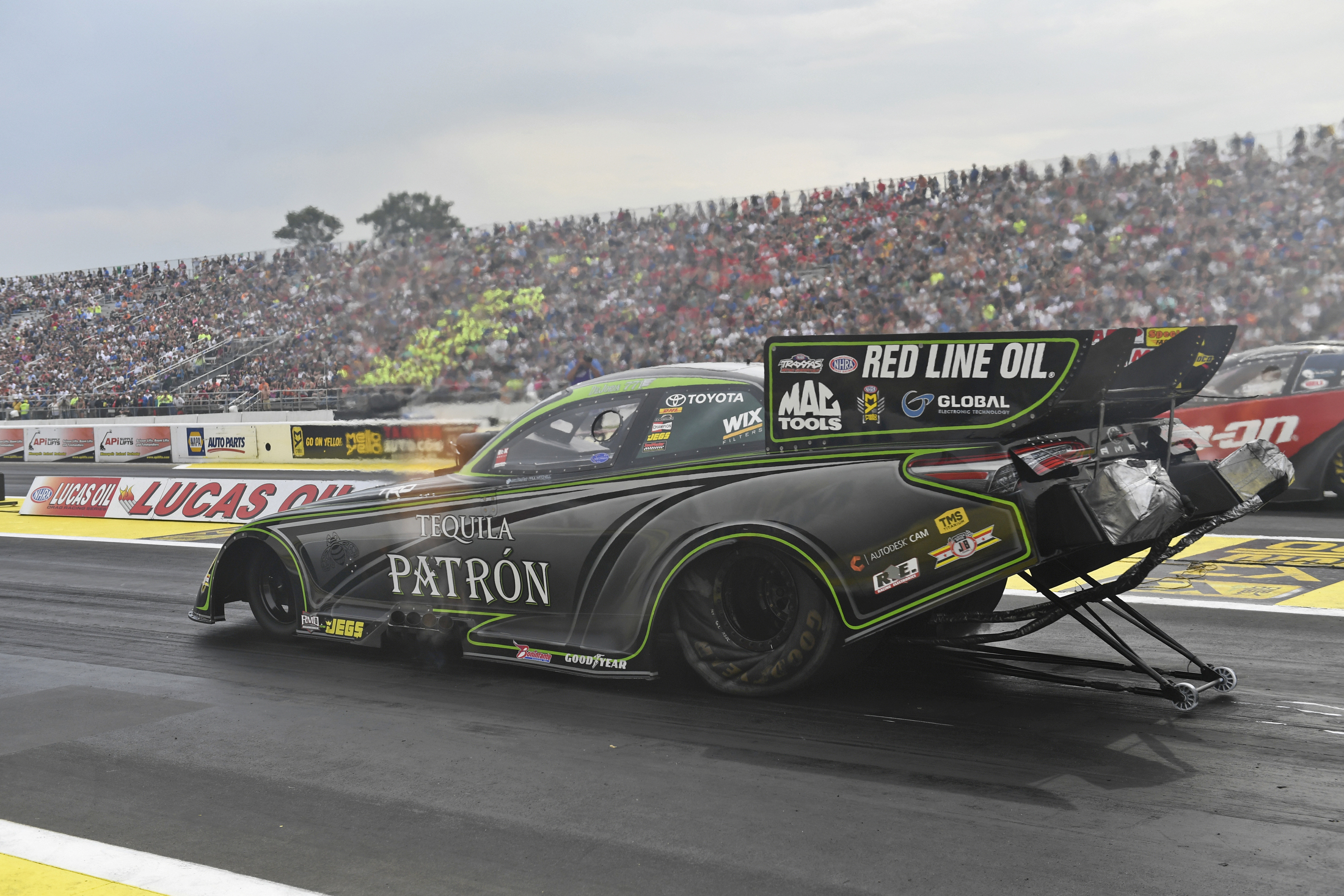 Tequila Patron Funny Car pilot Alexis DeJoria racing on Sunday at the Lucas Oil NHRA Nationals