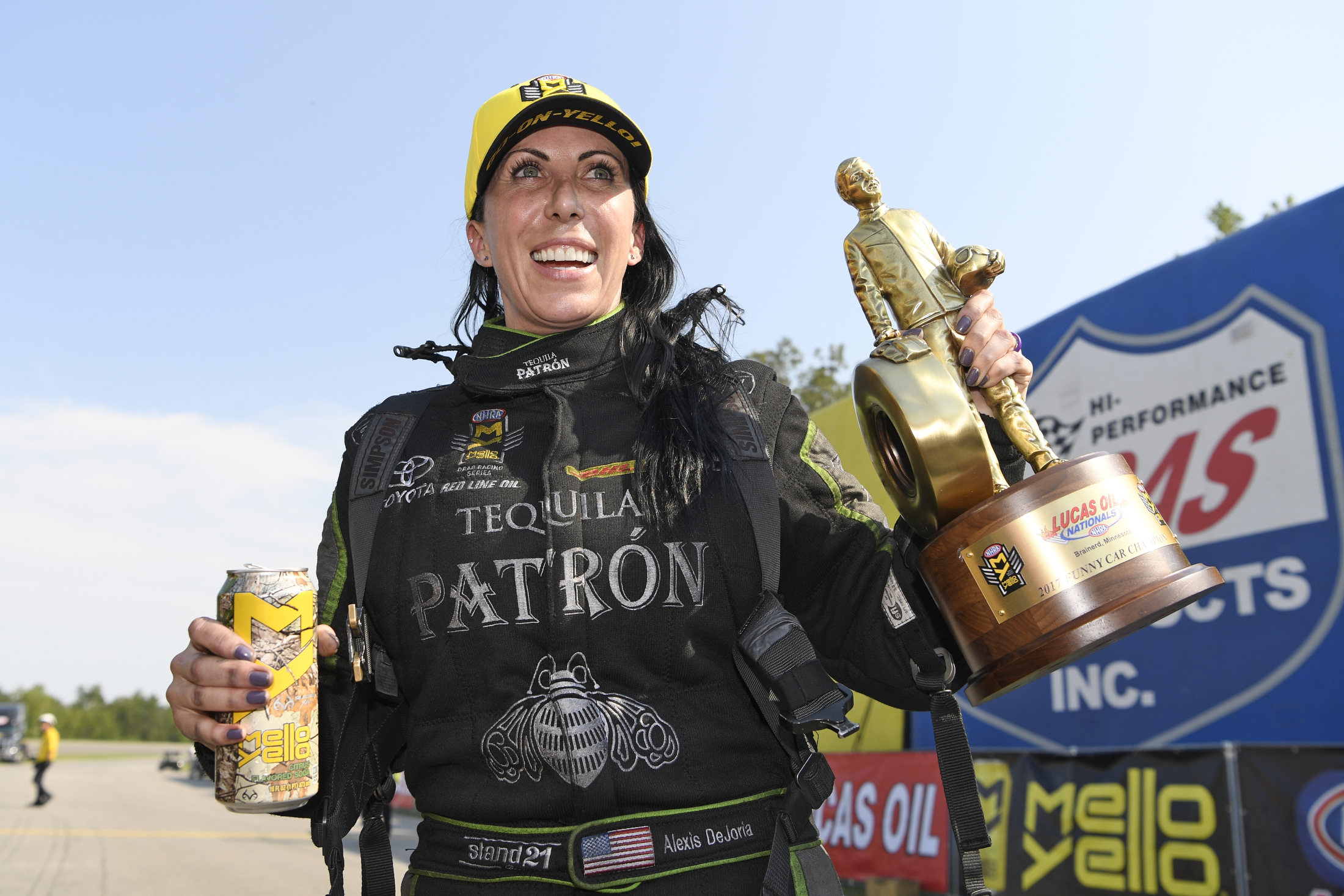 Tequila Patron Funny Car pilot Alexis DeJoria with the Wally at the Lucas Oil NHRA Nationals