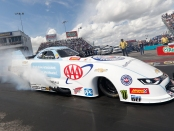 AAA sponsored Funny Car pilot Robert Hight racing on Sunday at the AAA Texas NHRA FallNationals