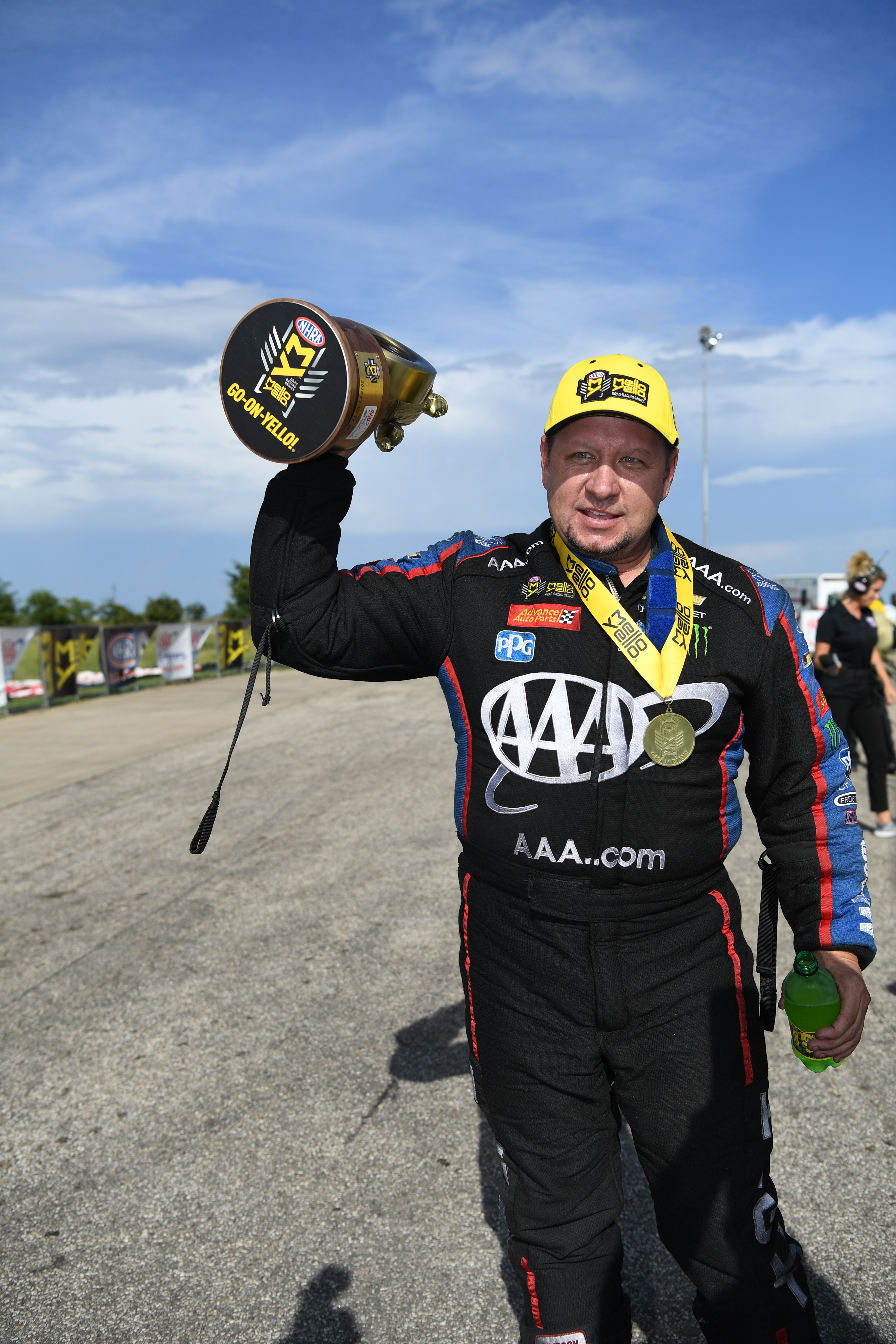 AAA sponsored Funny Car pilot Robert Hight with the Wally at the AAA Texas NHRA FallNationals