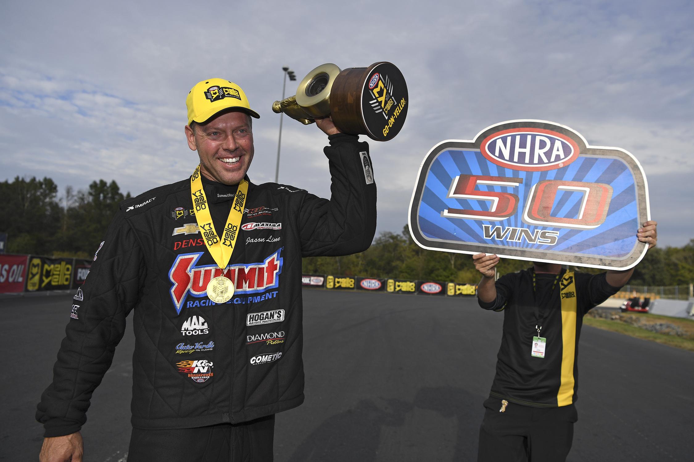 Summit Racing Equipment Pro Stock driver Jason Line with the Wally at the NHRA Carolina Nationals