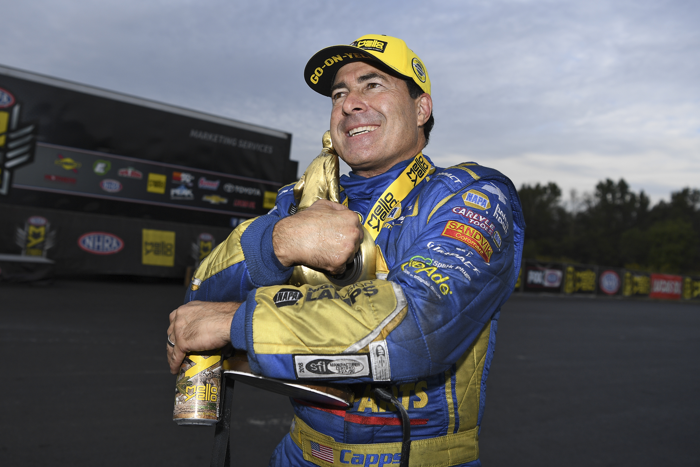 NAPA Auto Parts Funny Car pilot Ron Capps with the Wally after winning the NHRA Carolina Nationals