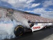 Capco Contractors Top Fuel Dragster pilot Steve Torrence racing on Saturday at the NTK NHRA Carolina Nationals