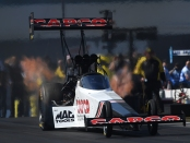 Capco Contractors Top Fuel Dragster pilot Steve Torrence racing on Monday at the NTK NHRA Carolina Nationals