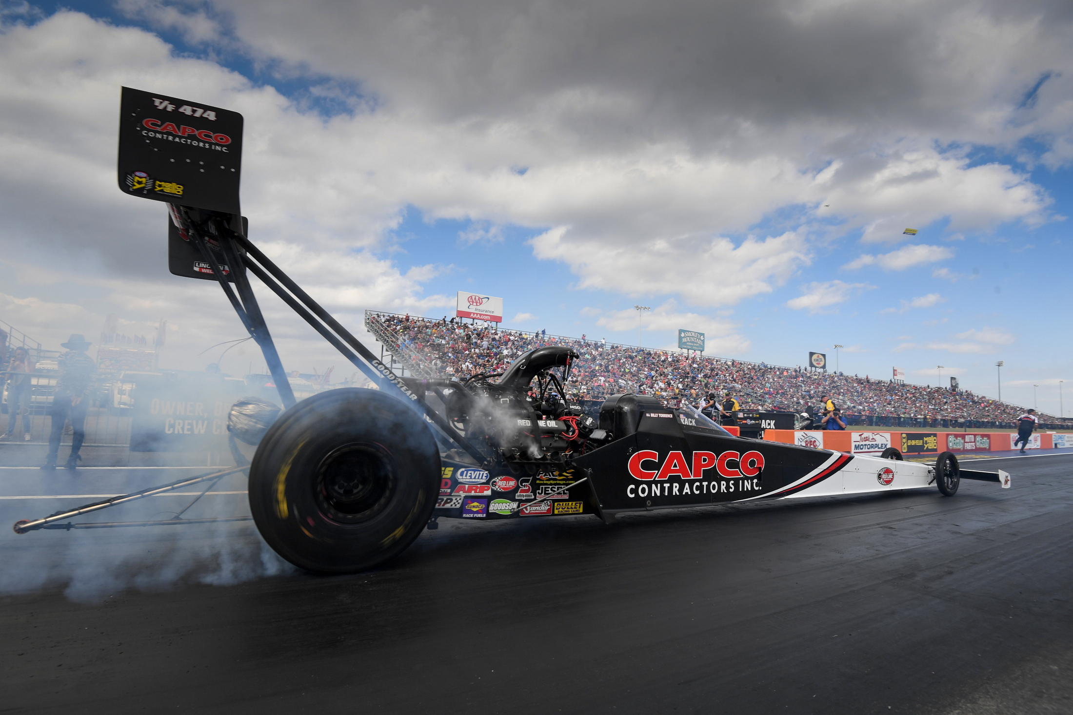 Capco Contractors Top Fuel Dragster pilot Billy Torrence racing on Sunday at the AAA Texas NHRA FallNationals