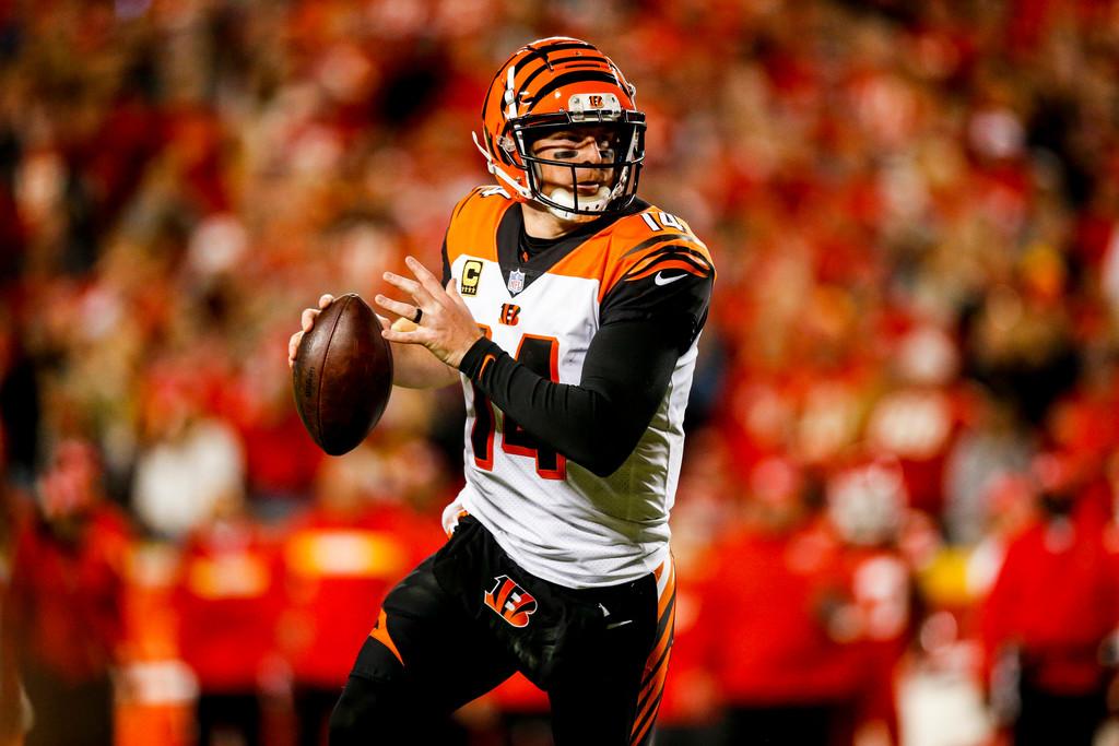 Cincinnati Bengals quarterback Andy Dalton rolls out of the pocket during the second quarter against the Kansas City Chiefs