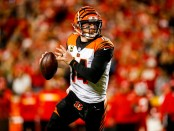 Cincinnati Bengals quarterback Andy Dalton rolls out of the pocket during the second quarter against the Kansas City Chiefs