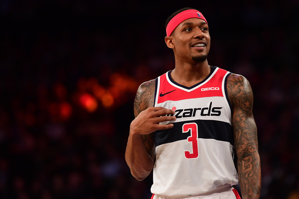 Washington Wizards guard Bradley Beal smiles during a timeout against the New York Knicks