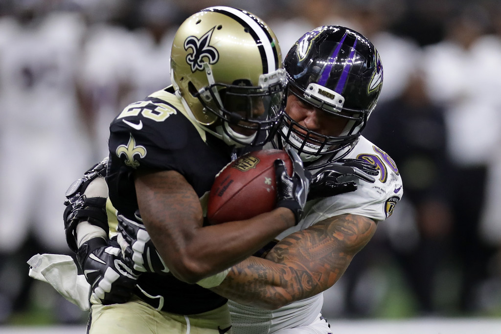 Former Baltimore Ravens defensive lineman Brent Urban tackles Marcus Murphy against the New Orleans Saints