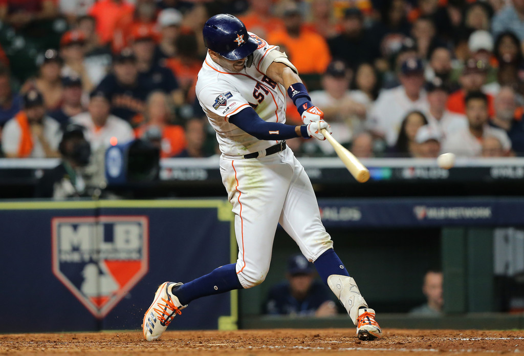 Houston Astros shortstop Carlos Correa hits a double against the Tampa Bay Rays in Game 2 of the American League Divisional Series