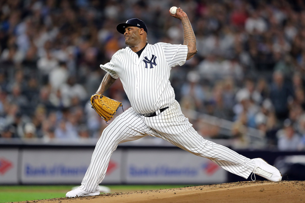 Former New York Yankees pitcher C.C. Sabathia throws a pitch against the Boston Red Sox in Game Four of the American League Division Series