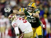 Former Green Bay Packers linebacker Clay Matthews sacks San Francisco 49ers quarterback C.J. Beathard