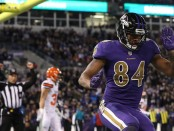 Former Baltimore Ravens tight end Darren Waller celebrates a touchdown against the Cleveland Browns