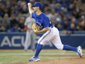 Former Toronto Blue Jays pitcher Dave Bush delivers a pitch against the Boston Red Sox