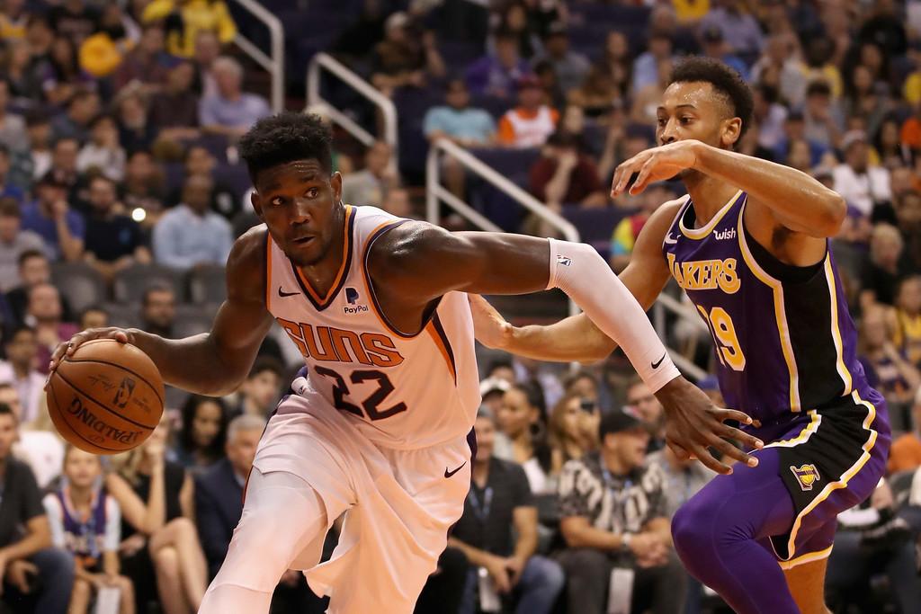 Phoenix Suns center Deandre Ayton handles the ball against the Los Angeles Lakers