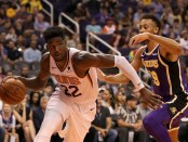 Phoenix Suns center Deandre Ayton handles the ball against the Los Angeles Lakers