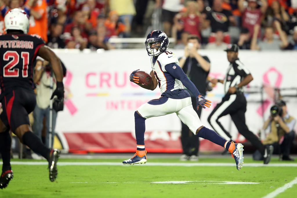 Denver Broncos wide receiver Emmanuel Sanders scores a 64-yard touchdown reception against the Arizona Cardinals