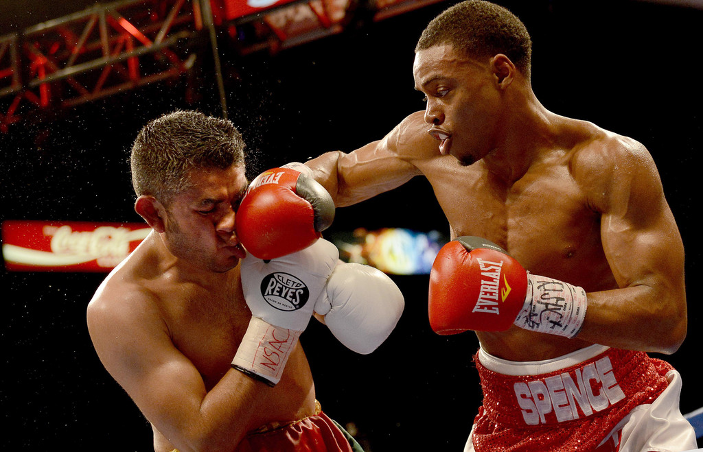 Professional boxer Errol Spence Jr. hits Javier Castro in the face with a punch during their junior middleweight fight