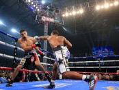 Undefeated professional boxer Errol Spence Jr. throws a punch at Carlos Ocampo in the first round of their IBF Welterweight Championship bout