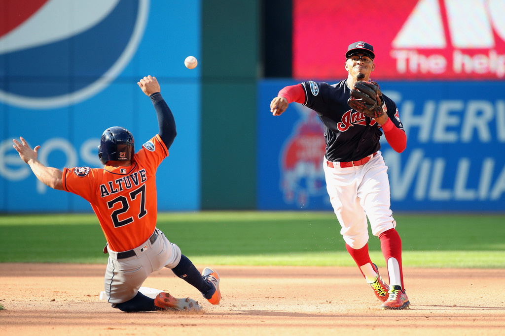 Cleveland Indians shortstop Francisco Lindor gets José Altuve out before throwing to first base in the 2018 American League Division Series against the Houston Astros