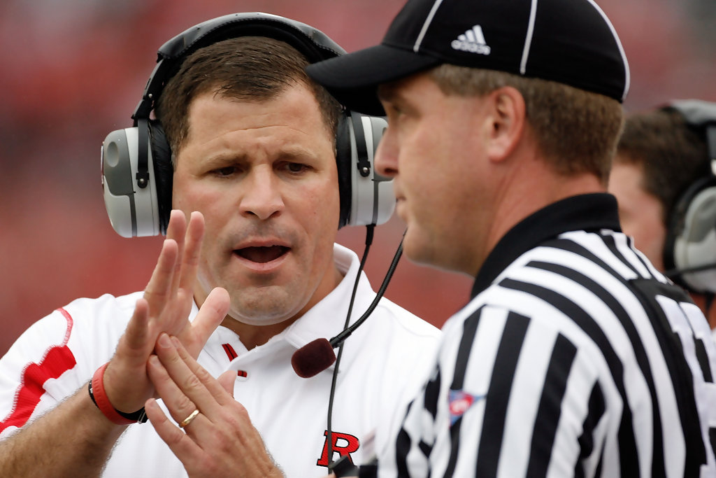 Former Rutgers Scarlet Knights head coach Greg Schiano talks to an official about a call against the Morgan State Bears