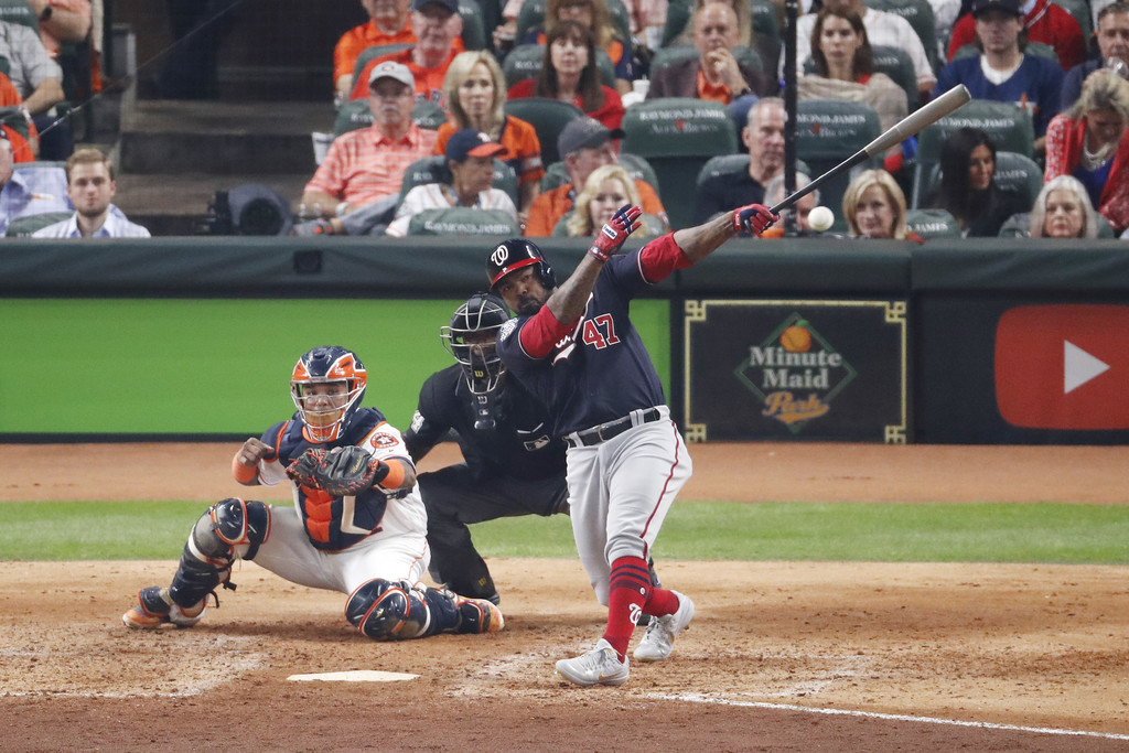Washington Nationals infielder Howie Kendrick lines out against the Houston Astros in Game One of the 2019 World Series