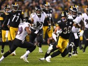 Pittsburgh Steelers running back James Conner carries the ball against the Baltimore Ravens