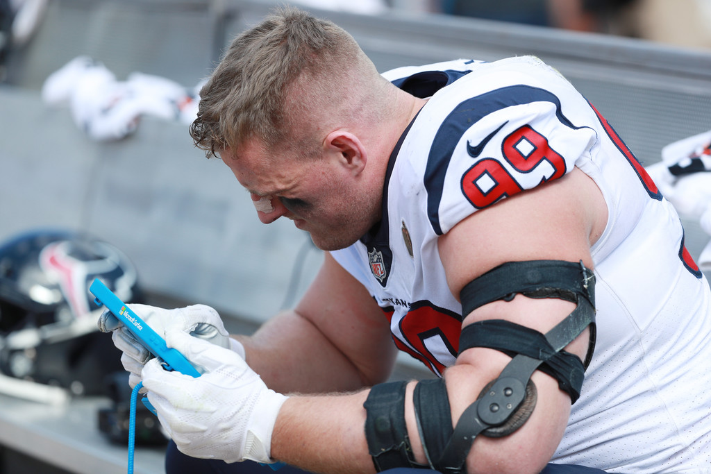 Houston Texans star defensive end J.J. Watt waits in the team area during their game against the Jacksonville Jaguars