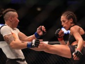 UFC female fighter Joanna Jędrzejczyk fights against Jéssica Andrade in their Women's Strawweight title bout at UFC 211