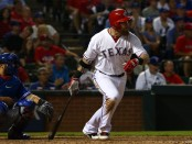Former Texas Rangers outfielder Josh Hamilton hits a double against the Toronto Blue Jays
