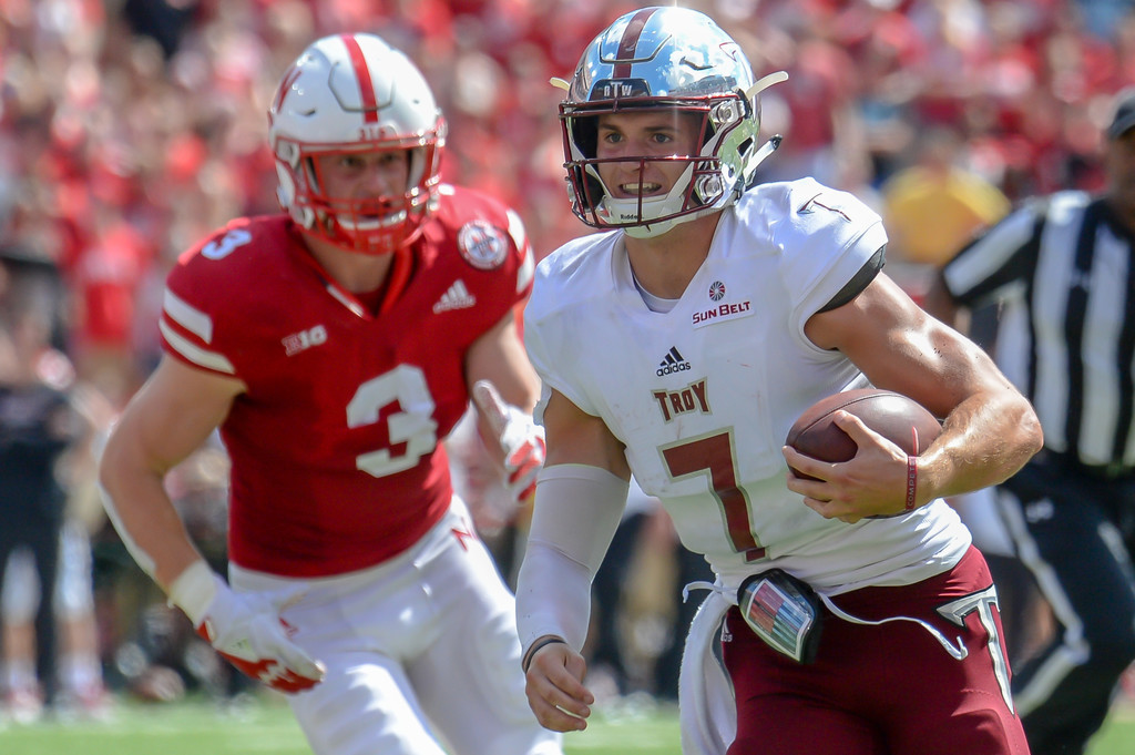 Troy Trojans quarterback Kaleb Barker runs from Will Honas against the Nebraska Cornhuskers