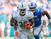Miami Dolphins running back Kenyan Drake rushes for a touchdown against the Detroit Lions