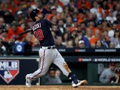 Washington Nationals catcher Kurt Suzuki hits a fly out against the Houston Astros in Game 1 of the 2019 World Series