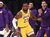 Los Angeles Lakers forward LeBron James reacts to a play in front of the bench against the Houston Rockets