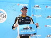 Toco Warranty Ford driver Clint Bowyer poses with the pole award after qualifying for the Monster Energy NASCAR Cup Series South Point 400
