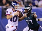 Former Philadelphia Eagles defensive end Michael Bennett attempts to sack Eli Manning against the New York Giants