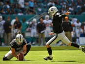 Former Oakland Raiders kicker Mike Nugent kicks a field goal against the Miami Dolphins