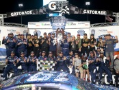 Driver Martin Truex Jr. celebrates in Victory Lane after winning the First Data 500