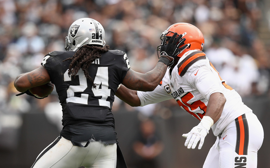 Cleveland Browns defensive end Myles Garrett attempts to tackle Marshawn Lynch, who straight arms, the defensive end against the Oakland Raiders