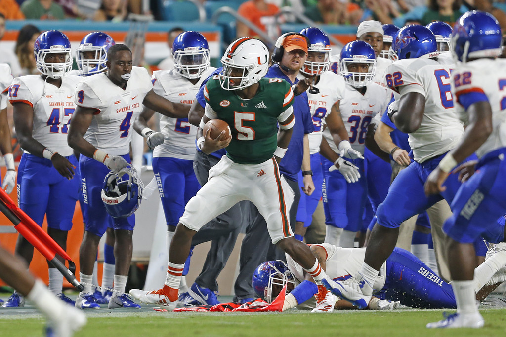 Miami (Florida) Hurricanes quarterback N'Kosi Perry runs the ball against the Savannah State Tigers
